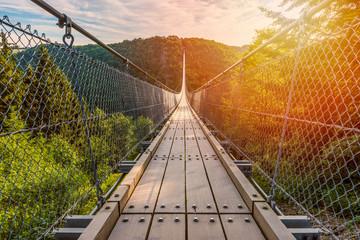 Suspension Footbridge in Mörsdorf Germany around sunrise