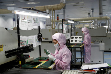 Filipinos work at Kinpo Electronics factory in Malvar