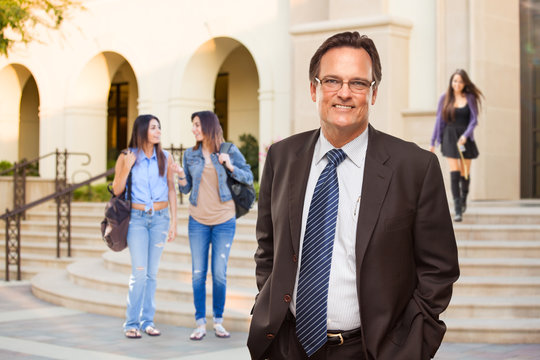 Male Adult Administrator In Suit and Tie Walking on Campus
