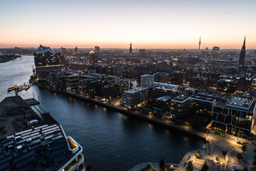"Aerial view of the harbor district, the concert hall ""Elbphilharmonie"" and downtown Hamburg, Germany, at dusk."