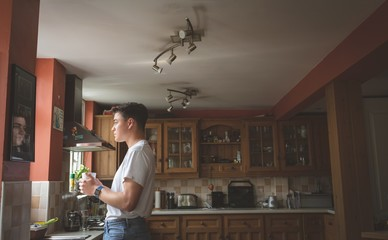 Man having coffee in the kitchen