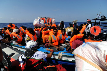 Migrants are rescued by SOS Mediterranee organisation and Doctors Without Borders during a search and rescue (SAR) operation with the MV Aquarius rescue ship in the Mediterranean Sea