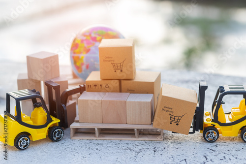 Mini forklift truck load cardboard box with shopping cart