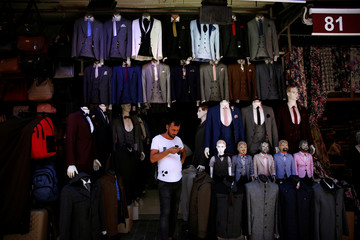 A shopkeeper waits for customes at Mahmutpasa street, a popular middle-class shopping district, in Istanbul