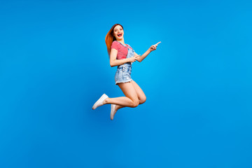 Full-size excited cheerful careless girl demonstrating empty pla