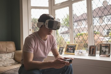 Man playing video game in virtual reality headset
