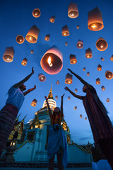 lanterns ballon release by people floating to blue sky for make a wish for the future, Thailand