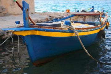 Old wooden boat fixed on dock, Island Krapanj, Croatis