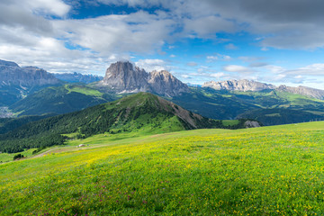Beautiful view of countryside and green field with blue sky background on summer from Dolomites, Italy.