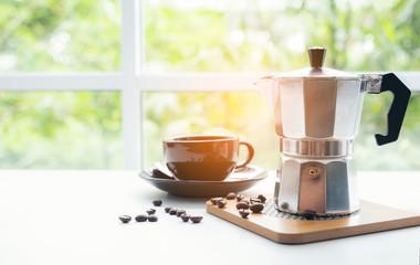 Cup and Bid silver coffee pot on Desktop