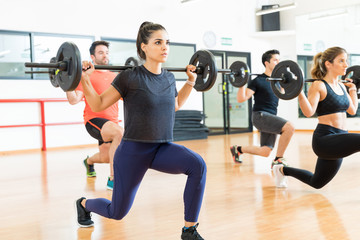 Weightlifter Lifting Barbell While Doing Lunges With Friends