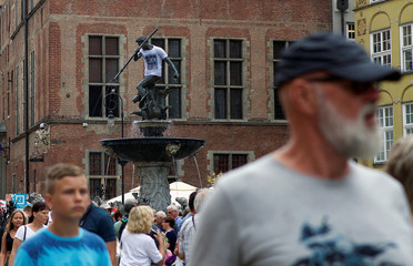 A statue of the sea god Neptune is seen dressed up in a T-shirt with the slogan 'Constitution' in Gdansk