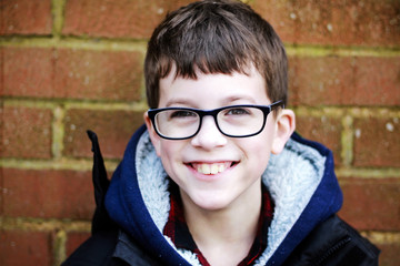 Boy with glasses outside