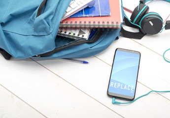 Smartphone with Headphones and School Bag Mockup