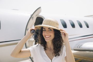 Young woman passenger departing from the plane on arrival at the airport.