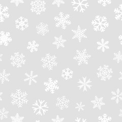 Christmas seamless pattern of snowflakes, white on light gray background