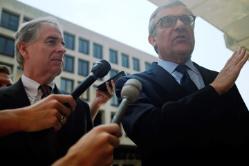 Peter Flaherty, Chairman of NLPC, and Paul Kamenar, attorney for Roger Stone's associate Andrew Miller, speak to reporters outside U.S. District Court n Washington