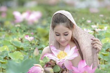 Beautiful Woman Relaxing With Lotus Flower
