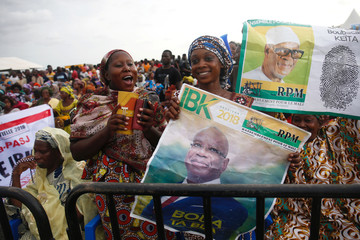 Supporters of Ibrahim Boubacar Keita, President of Mali and candidate of Rally for Mali party (RPM), carry his pictures during a rally, ahead of the second round of Mali's presidential election, in Bamako