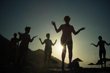 Sunrise silhouette Yoga on the beach Turkey