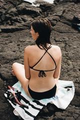 Back view woman in bikini with snorkel gear