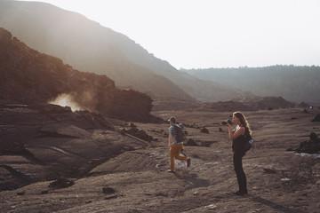 People exploring volcanic area