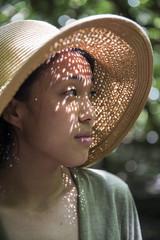 Woman in woven hat