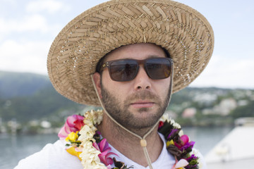 Man in sunglasses and hat on vacation