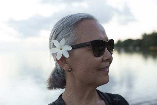 Woman with plumeria in her hair