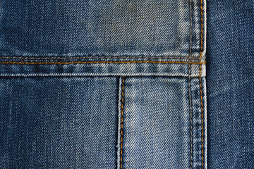 Neat stitching on the pocket of blue denim jeans
