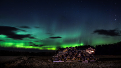 Northern Lights with a isolated house in the foreground