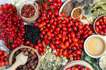 Medicinal plants and herbs composition: Dog rose, bunch branch Rosehips, types Rosa canina hips, essential oil. bunch, dried flowers of linden and chamomile elderberries and goji berries.