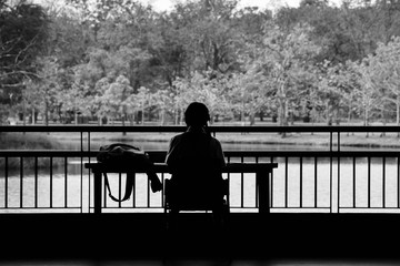 alone girl sit in the park - monochrome