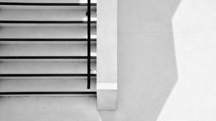 concrete ladder with shadow in the city - monochrome