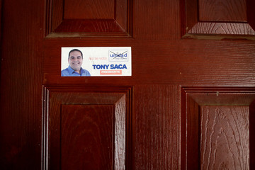 A presidential campaign sticker is seen on a door in a house of El Salvador's former President Elias Antonio Saca seized by the Attorney General's Office in San Salvador