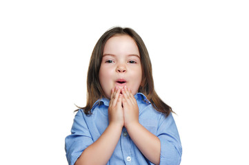 Pretty little girl in a white studio expressing amazement