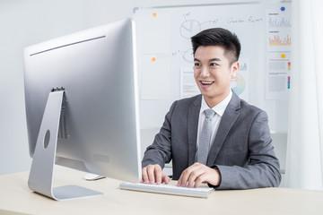 Happy man working in office