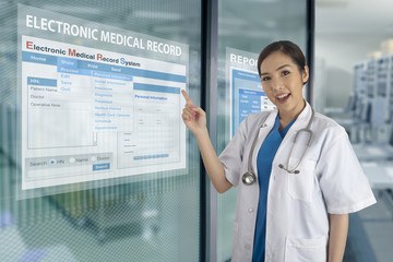 Wall Mural - Electronic medical record system show on transparent display on glass windows.