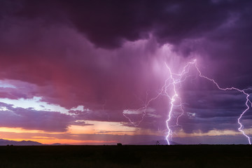Lightning and thunderstorm at sunset