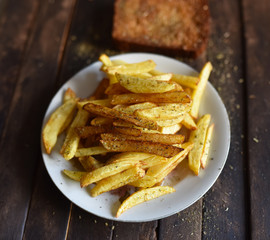 French fries on a white plate fried bread