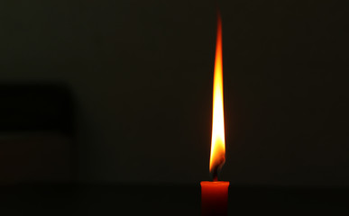 Bright waxy candle burns down