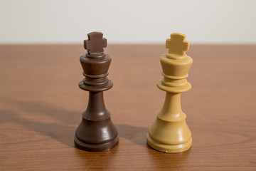 Chess, king pieces on a decorated wood table