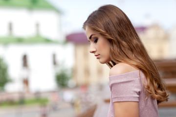 Portrait of a beautiful teenage girl outdoors.