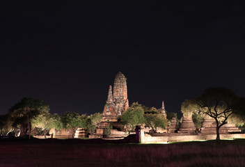 Night shot of the Main Phra Prang in corn shape and small stupa around the main in the ruins of ancient remains at Wat Phra Ram temple, it built in 1369 AD in the Ayutthaya period.