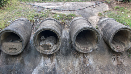 Dry concrete pipes for drainage water on shore. Sewage system.