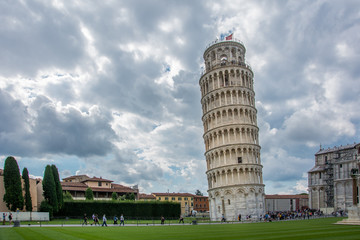 The Leaning Tower of Pisa, Italy, with the dramatic sky. The tower, located on Piazza dei Miracoli and famous for its tilt, is one of the iconic landmarks of Italy
