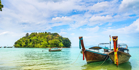 Amazing view of beautiful beach with longtale boats. Location: Krabi, Thailand, Andaman Sea. Artistic picture. Beauty world. Panorama