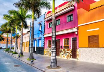 Foto auf Acrylglas Kanarische Inseln Tenerife. Colourful houses and palm trees on street in Puerto de la Cruz town, Tenerife, Canary Islands, Spain