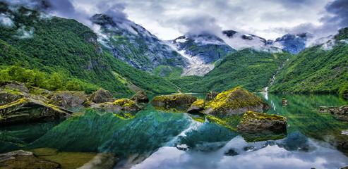Foto auf Leinwand Skandinavien Amazing lake on a background of mountains and glacier. Norway. Beautiful landscape. Artistic picture. Beauty world. Panorama