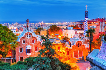 Barcelona, Spain. Amazing night cityscape of Barcelona, view on Park Guell, creation of famous architect Antonio Gaudi. UNESCO world heritage list site, popular European travel destination.